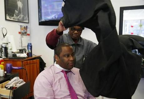 Everard Bentley prepared to cut Tito Jackson's hair. Top Notch's owner, Cleon James, said he and others helped clear crime from the neighborhood but now fear they may be priced out.
